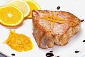 Fried tuna fillet with fresh orange and orange sauce — Stock Photo
