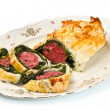Italian cotechino in crust with spinach — Stock Photo