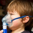 Stock Photo: Child taking respiratory, inhalation therapy