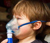 Child taking respiratory, inhalation therapy — Stock Photo