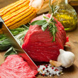 Raw beef on wooden table — Stock Photo
