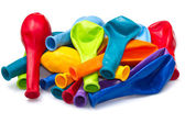 Colorful deflated balloons, isolated on white — Stock Photo