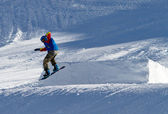 Portrait of snowboarder doing extreme trick — Stock Photo