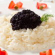 Rice with black caviar - Stock Photo