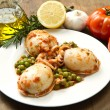 Cuttlefish with peas - Stock Photo