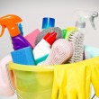 Full box of cleaning supplies and gloves isolated on white — Zdjęcie stockowe