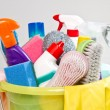 Full box of cleaning supplies and gloves isolated on white — Stock Photo