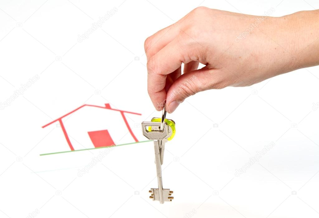 A bunch of House key  with house in backgrounds  Stock Photo #21089905