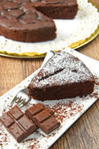 Piece of chocolate cake with fresh berry — Stock Photo