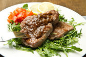 Fresh grilled red meat with vegetables and sauce — Stock Photo