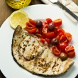 Swordfish with tomatoes — Stock Photo