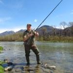 Fisherman on river — Stock Photo #24026117