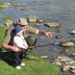 Father and daughter fishing on river — Stock Photo #24026513