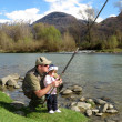 Father and daughter fishing on river — Stock Photo