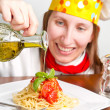 smiling chef garnish an Italian pasta dish — Stock Photo