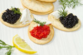 Black and red caviar canape — Stock Photo