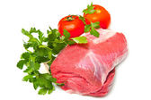 Piece of raw beef with parsley and tomatoes - isolated on white — Stock Photo