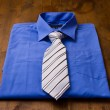 New blue man's shirt and tie — Stock Photo