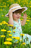 Happy girl on the meadow with white flowers — Stock Photo