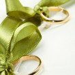 Gold wedding rings on white pillow — Stock Photo #24995237