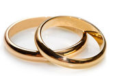 Couple of gold wedding rings on white background — Stock Photo