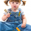 Baby girl with working tool — Stock Photo