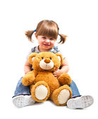 Adorable toddler girl hugging a teddy bear — Stock Photo