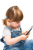 Little girl play with mobile phone — Stock Photo