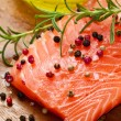 Fresh salmon fillet on wooden board — Stock Photo