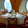 Restaurant on board a cruise ship ready for dinner — Stock Photo #27163031