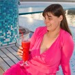 Woman enjoys traveling on cruise ship sipping a cocktail — Stock Photo #27163211