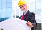 Architect Looking At Blueprint — Stock Photo