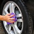 Outdoor tire car wash with sponge — Stock Photo #27439949