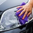 Hand with a wipe the car polishing — Photo