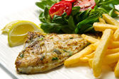 Grilled sea bream with potatoes — Stock Photo