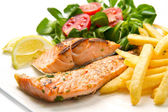 Salmon fillets with grilled potatoes — Stock Photo