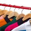 Lots of T-shirts on hangers — Stock Photo