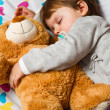 Sweet child sleeping with teddy bear  — Foto Stock