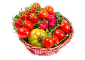 Tomatoes in a basket, isolated on white — Stock Photo