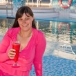 Woman enjoys traveling on cruise ship sipping a cocktail — Stock Photo