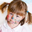 Stock Photo: Little girl draws paints