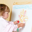 Little girl paint on a board with marker — Stock Photo