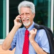 Successful businessman is speaking on his smartphone — Stock Photo #29276177