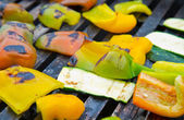 Bbq Piece of peppers and zucchini on the grill grate — Stock Photo