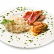 Rice with red mullet fillets and seafood — Stock Photo