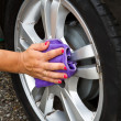 Outdoor tire car wash with sponge — Stock Photo