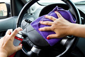 Woman's hand with microfiber cloth polishing wheel of a car — Stock Photo