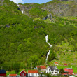 Village and Sea view on mountains in fjord, Norway — Stock Photo #29998529