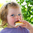 Baby girl with pizza  — Stock Photo