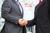 Handshake on background of buildings — Stock Photo